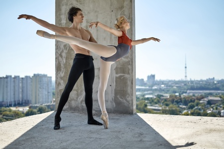 Ballet dancers posing at unfinished building